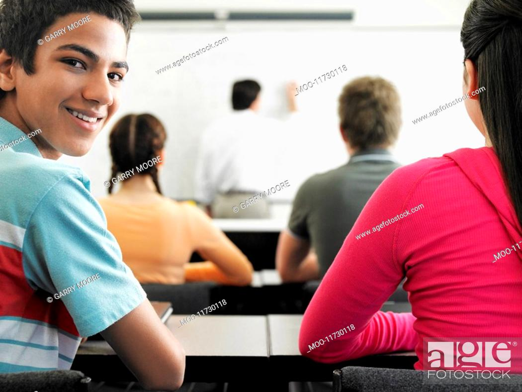 Stock Photo: Students sitting in classroom.