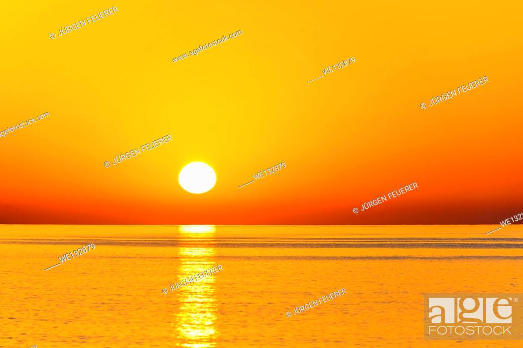 Stock Photo: Sunrise above the ocean at the beach of Tiwi, Sultanate of Oman.