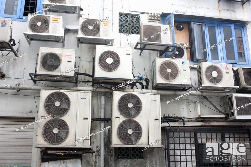Stock Photo: Airconditioning units on buildings.