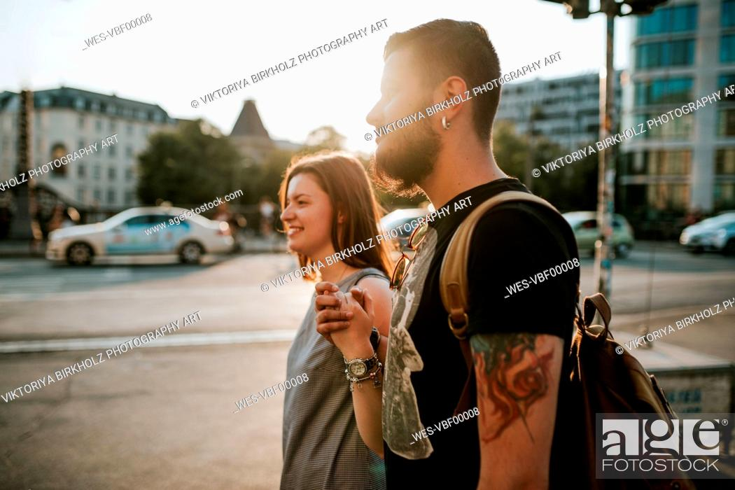 Stock Photo: Happy young couple walking in the city, Berlin, Germany.