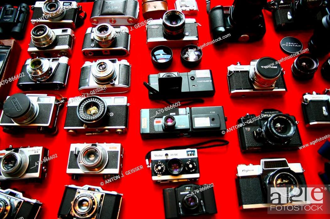 Stock Photo: Photo flea market old person similar cameras.