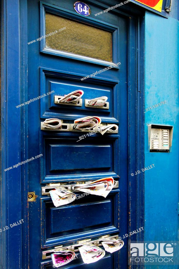 Stock Photo: France, Aquitaine, Gironde, door overloaded with mail.