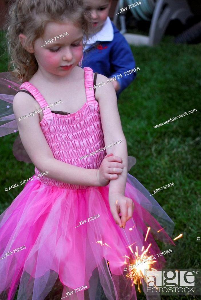 Stock Photo: Little girl with sparkler.