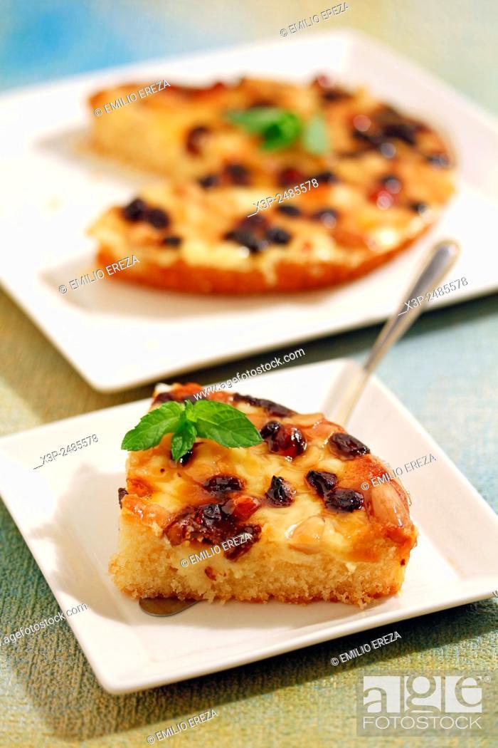 Stock Photo: Tart with walnuts, raisins and almonds.
