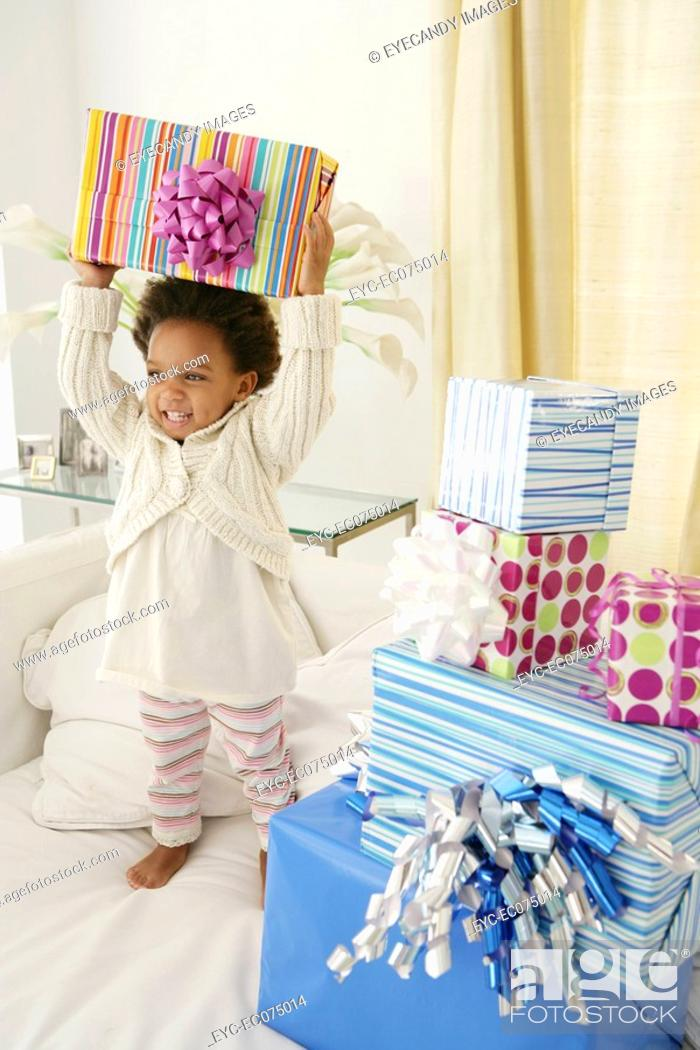 Stock Photo: African American child with birthday presents.