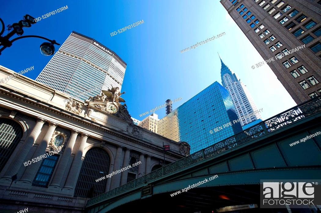 Stock Photo: Low angle view of urban buildings.