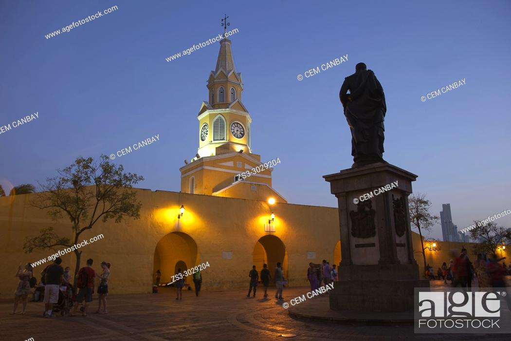 Stock Photo: View to the cathedral with clock tower by night in the historic center with the statue of Pedro De Heredia in the foreground, Cartagena de Indias, Bolivar.