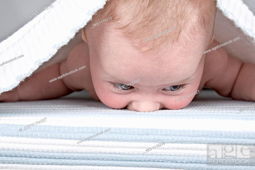 Stock Photo: Four Month old Baby under a Bed Sheet.