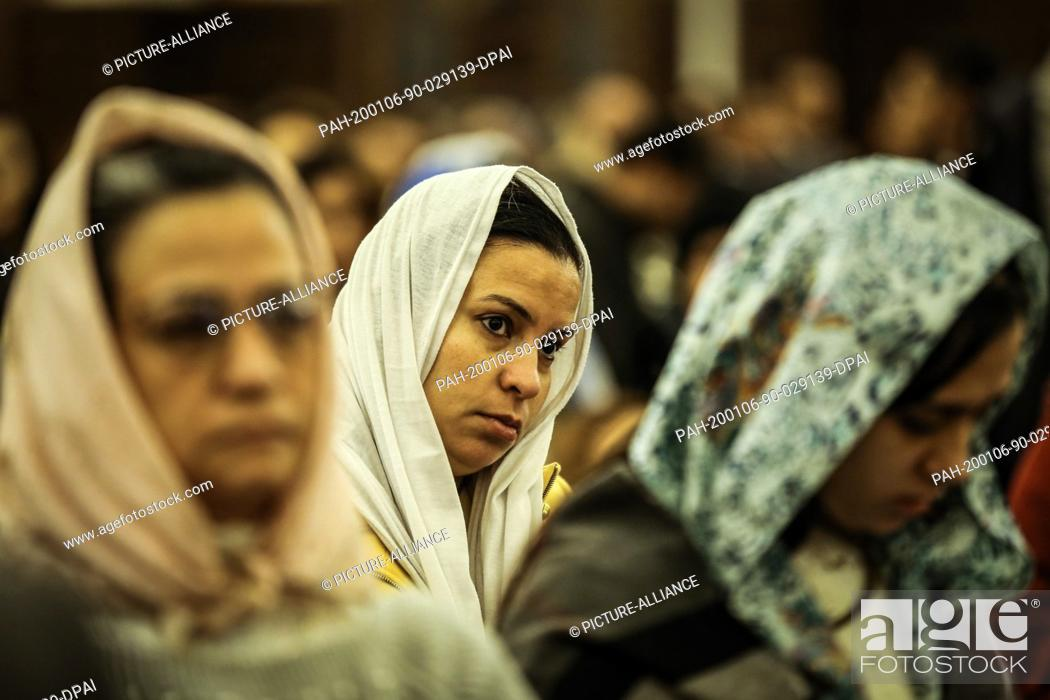 Stock Photo: 06 January 2020, Egypt, Cairo: Egyptian Orthodox Christians attend the ..Coptic Orthodox Christmas eve Mass, led by Pope Tawadros II of Alexandria and Patriarch.