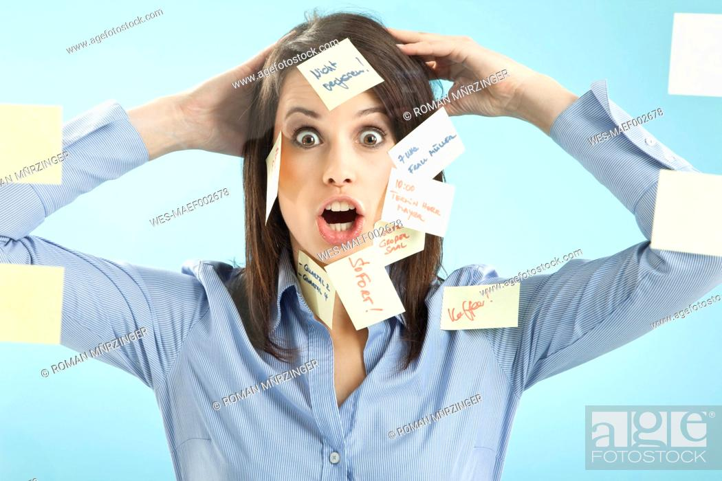 Stock Photo: Businesswoman with adhesive notes on her face.