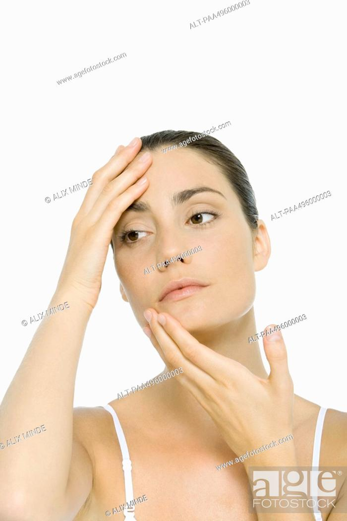 Stock Photo: Woman touching face, portrait.