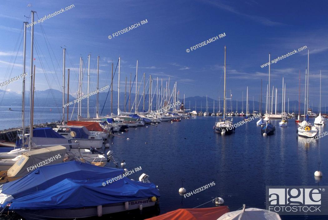 Stock Photo: Switzerland, La Cote, Vaud, Lake Geneva, Boats docked in the harbor along the lakefront in the town of Morges on Lac Leman.