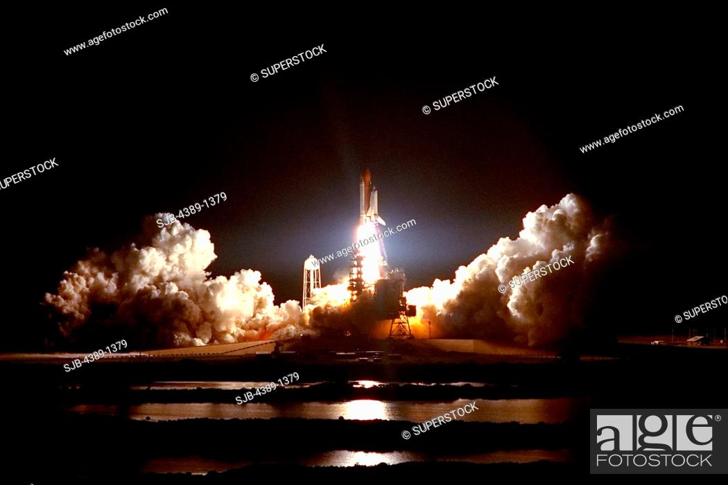Stock Photo: Nighttime Launch of Space Shuttle Atlantis on STS-86.