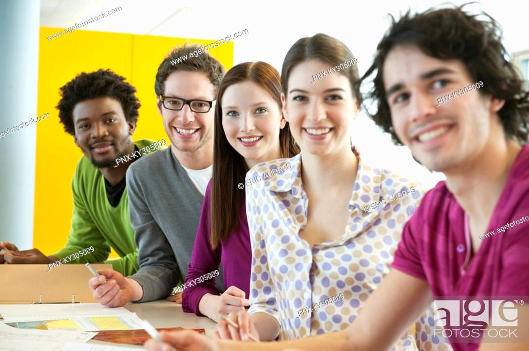 Stock Photo: Business executives smiling in an office.