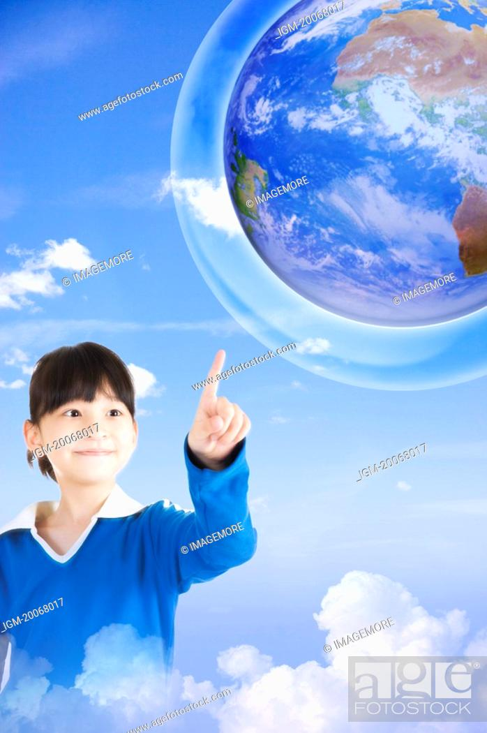 Stock Photo: Lohas, Environmental Conservation, Little girl pointing at the earth with smile.