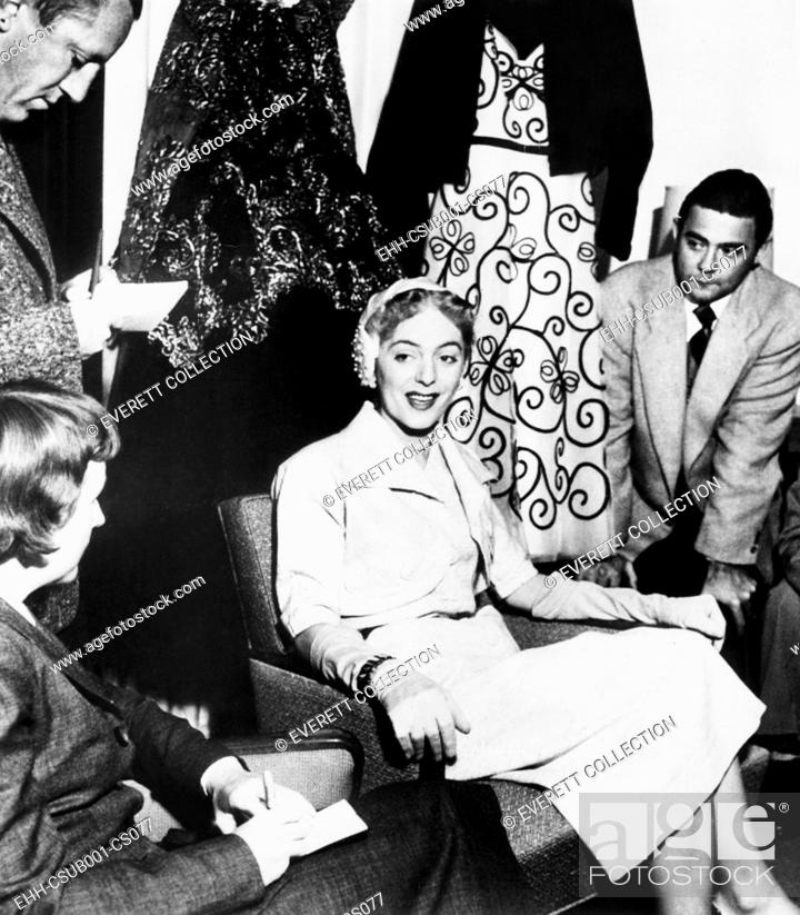 Imagen: Christine Jorgensen, displays her night club act wardrobe at a press conference. She expressed discomfort at 'being turned into a joke.