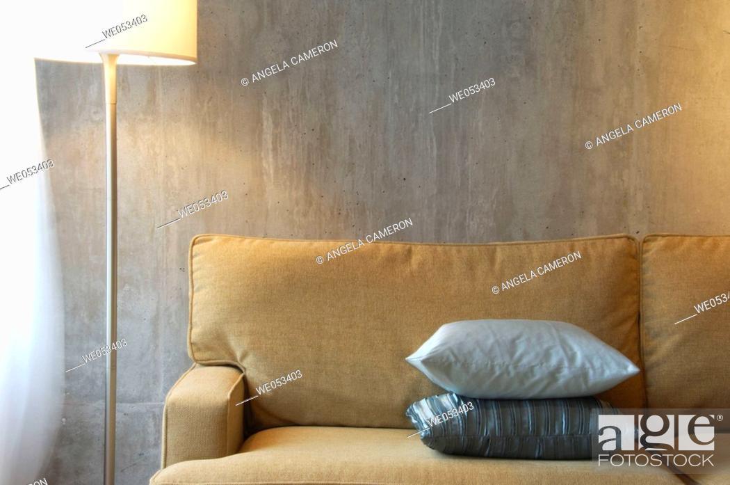 Stock Photo: modern/contemporary loft interior of sofa and lamp.