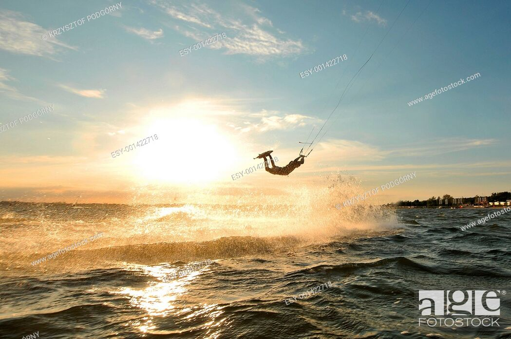 Stock Photo: Portrait of a kiteboarder before sunset.