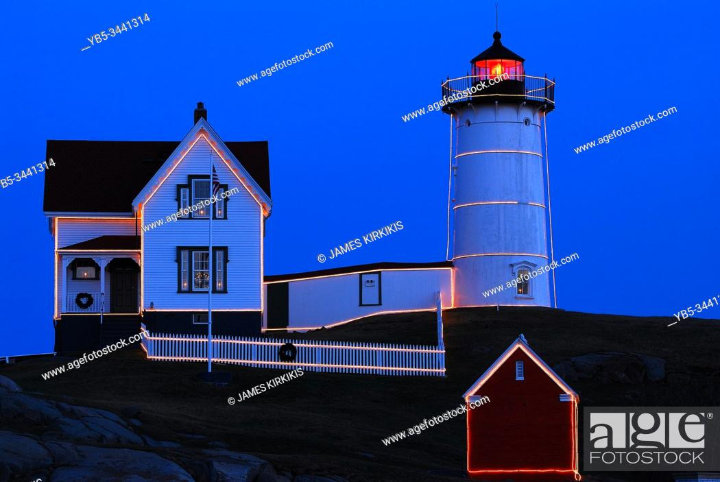 Stock Photo: The Nubble Lighthouse in Maine is lined in lights for Christmas.