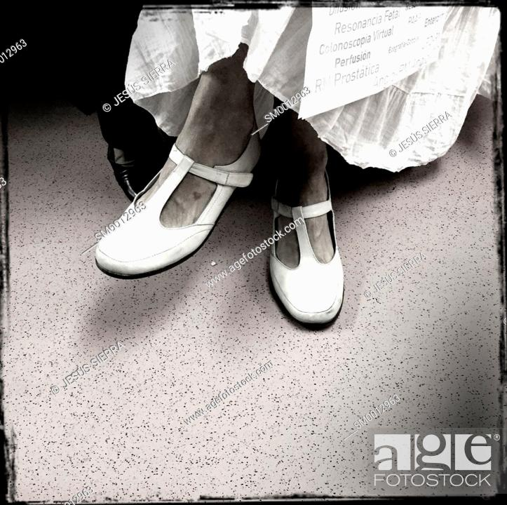 Stock Photo: Legs in metro Madrid, Spain.