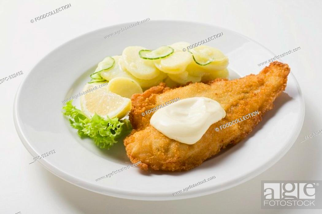 Stock Photo: Fish fillet with mayonnaise and potato salad.
