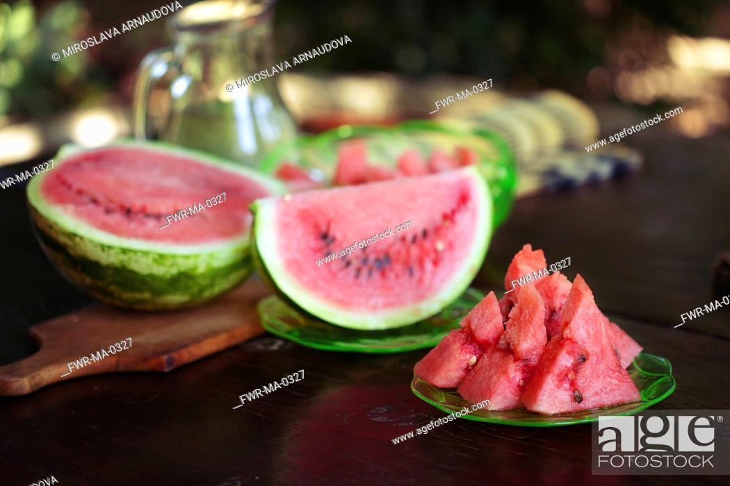 Imagen: Watermelon, Citrulus lanatus, Outdoor shot of sliced fruit showing red flesh and seed, ----.