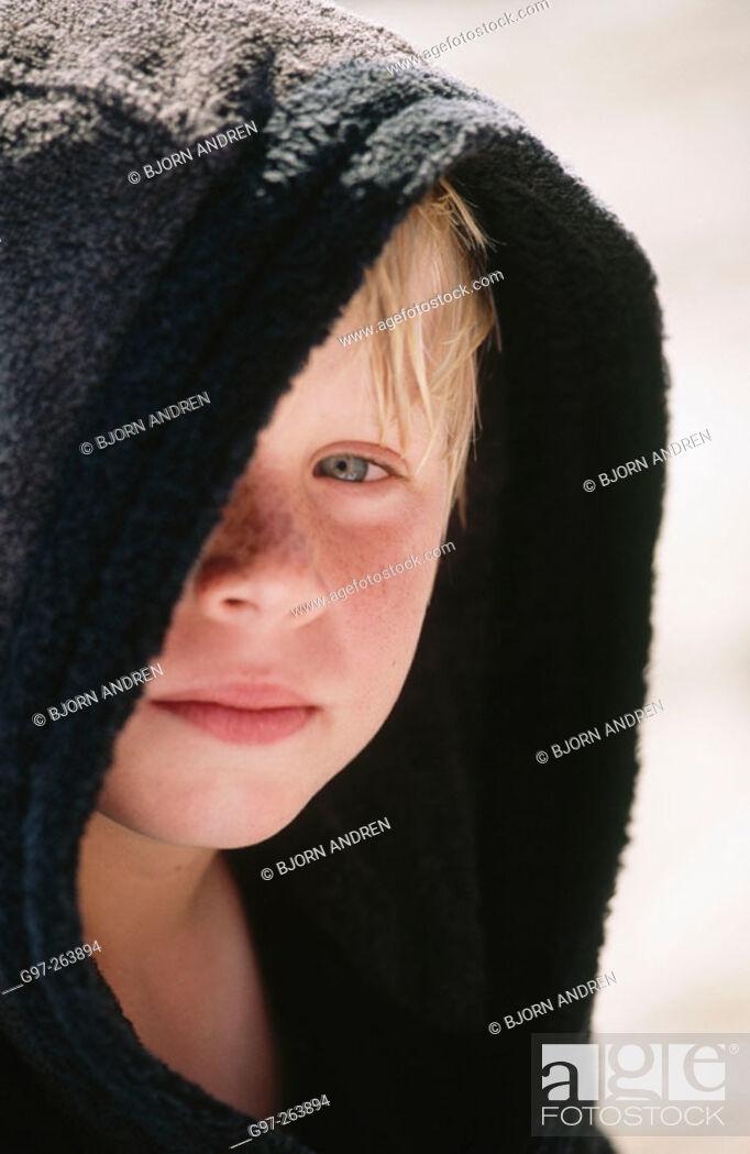 Stock Photo: Boy in black bathrobe.