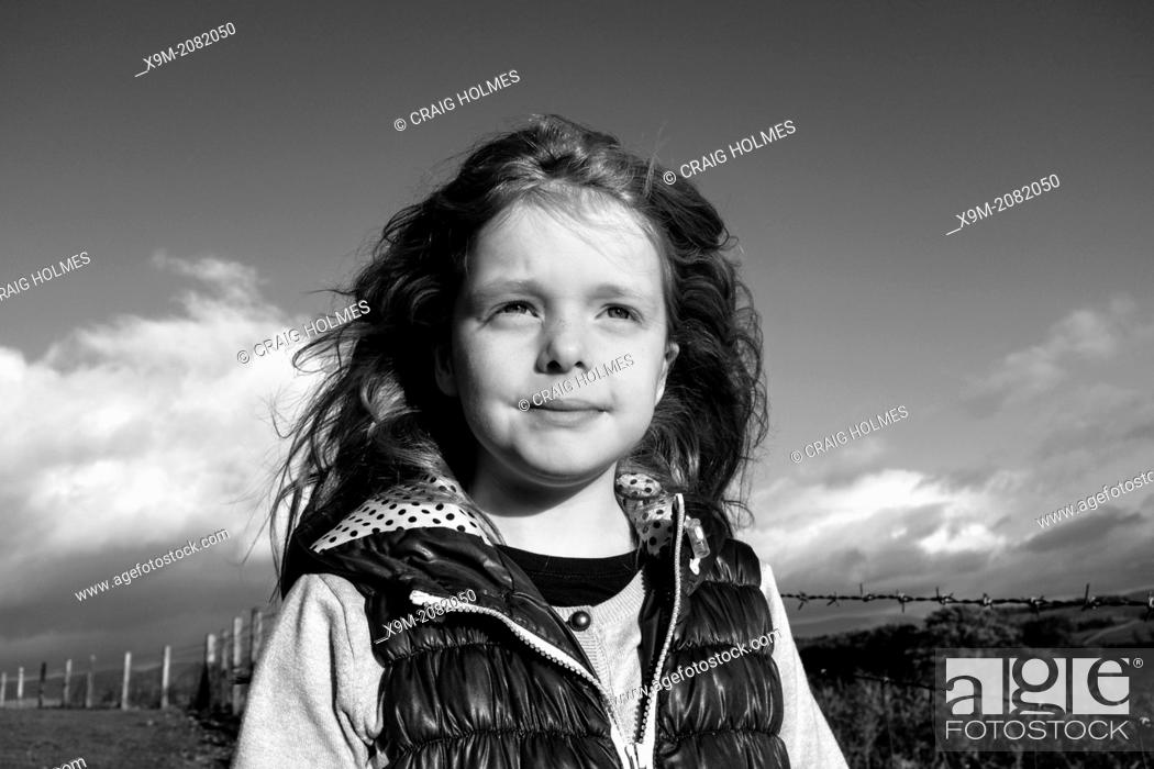 Stock Photo: Portrait of a girl in the countryside.