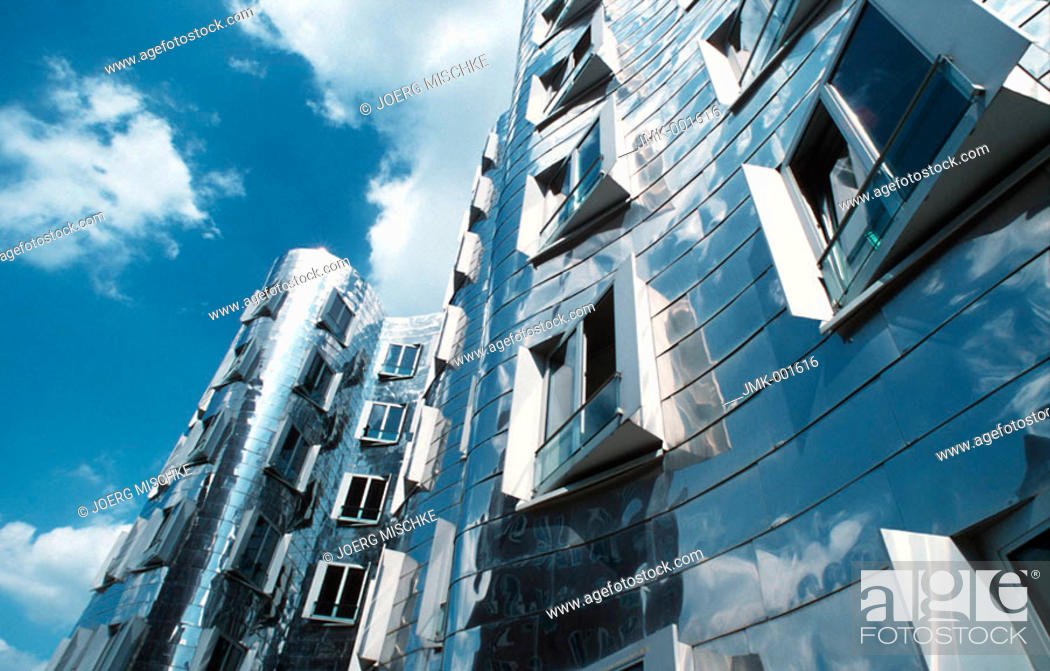 Stock Photo: A modern office block, office building, dynamic architecture, high-grade steel facade.