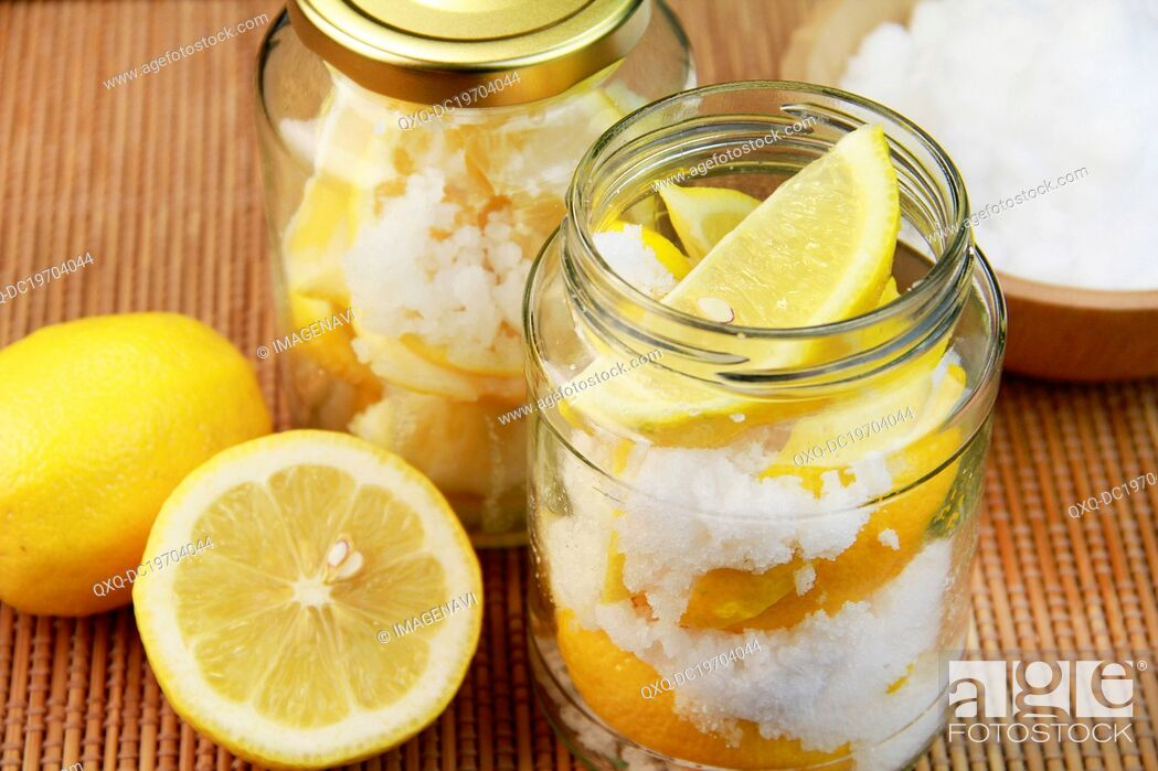 Imagen: Presereved lemon with salt in jar.
