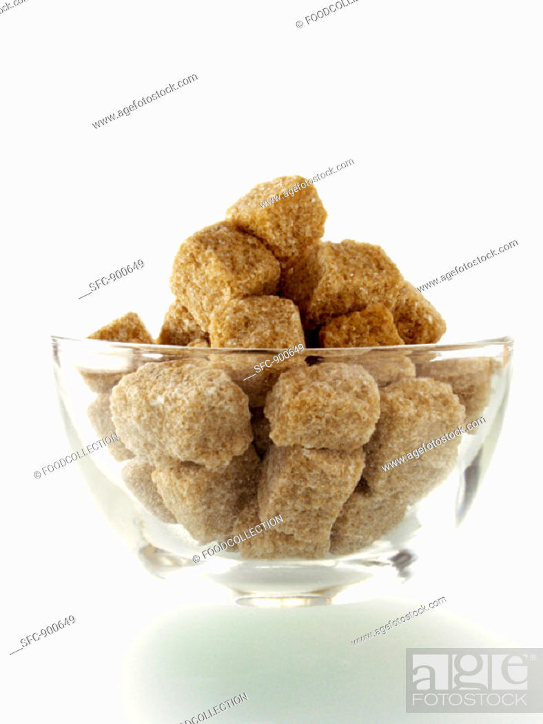 Stock Photo: Brown Sugar Cubes in a Glass Bowl.