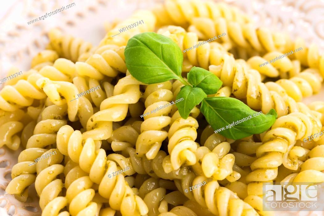 Stock Photo: italian fusilli pasta and fresh homemade pesto sauce.