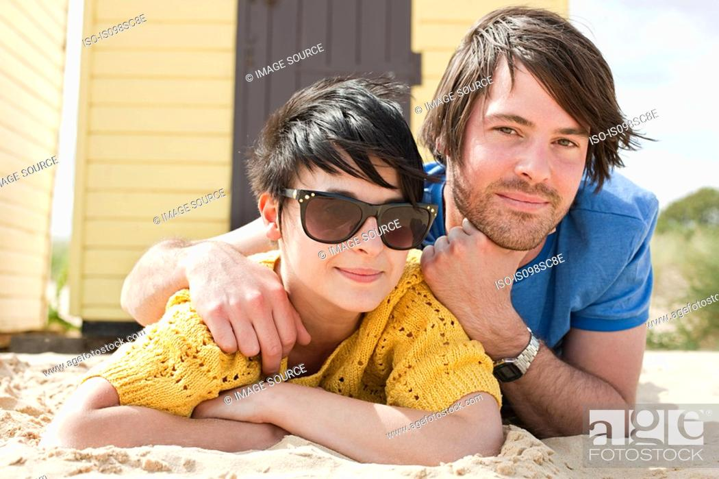 Stock Photo: Young couple by beach hut.