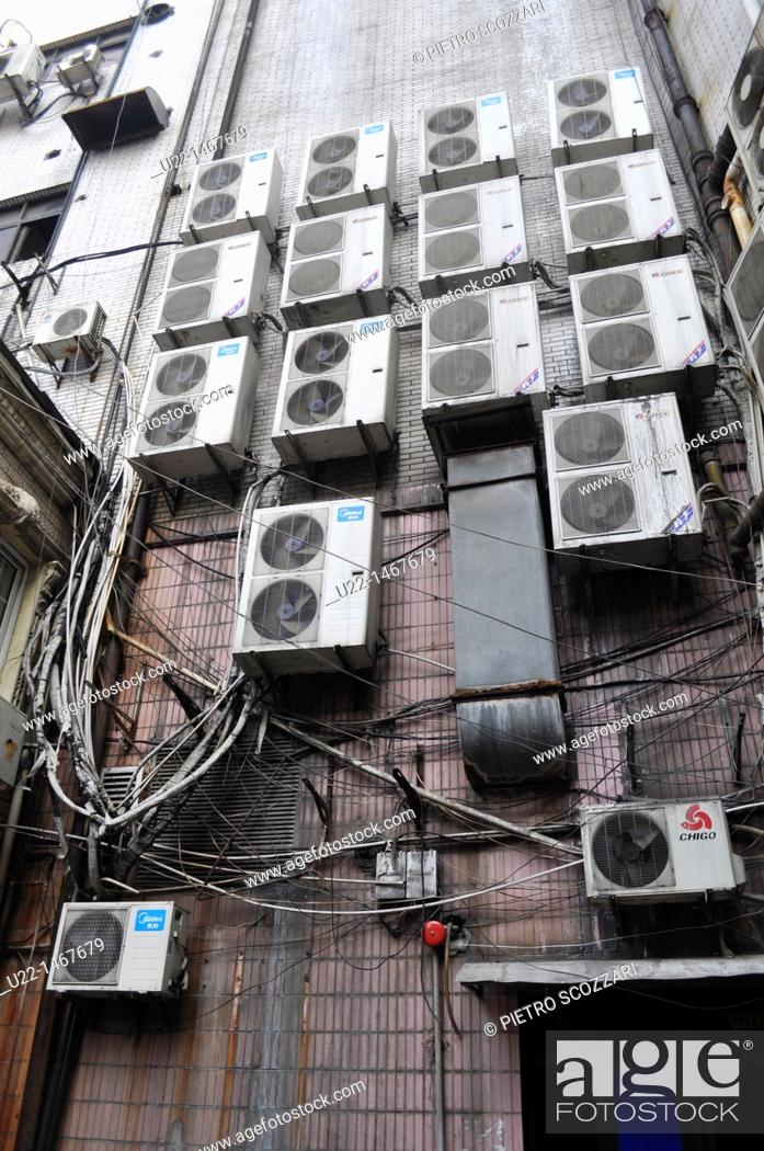 Stock Photo: Shanghai (China): air conditioning boxes by a condo in the French Concession.