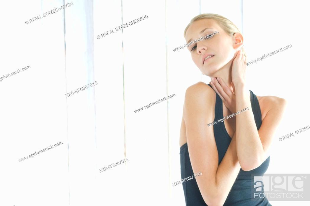 Stock Photo: woman massaging neck.