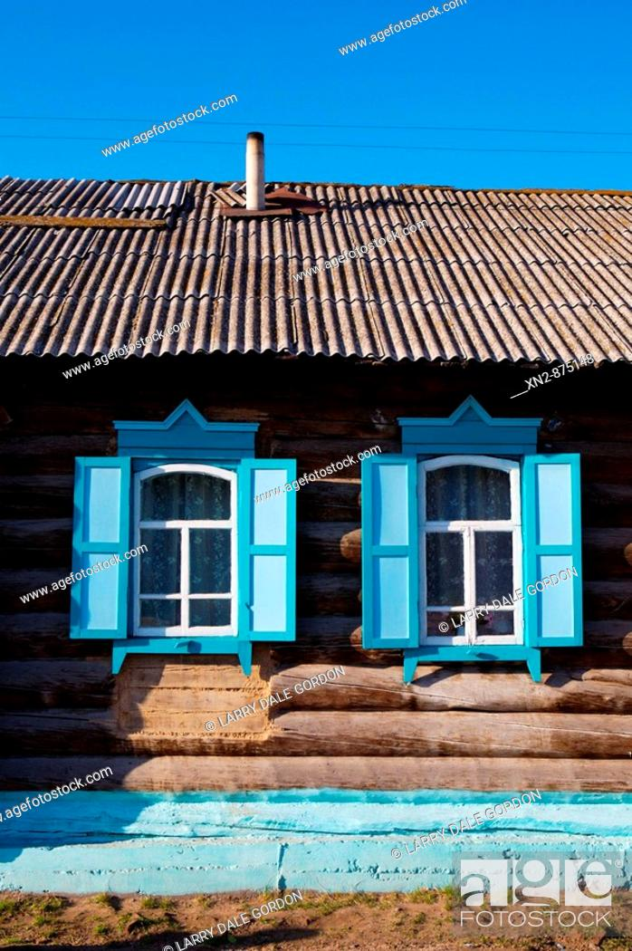 Stock Photo: Russia. Tarbagatai Villlage of Old Believers of original Russian Orthodox. Colorful window treatment.