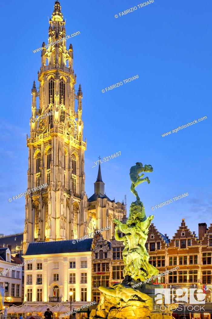 "Stock Photo: The Brabo fountain in the Grote Markt (""""Great Market Square"""") with the belfry of the Cathedral of Our Lady in the background of Antwerp, Belgium."
