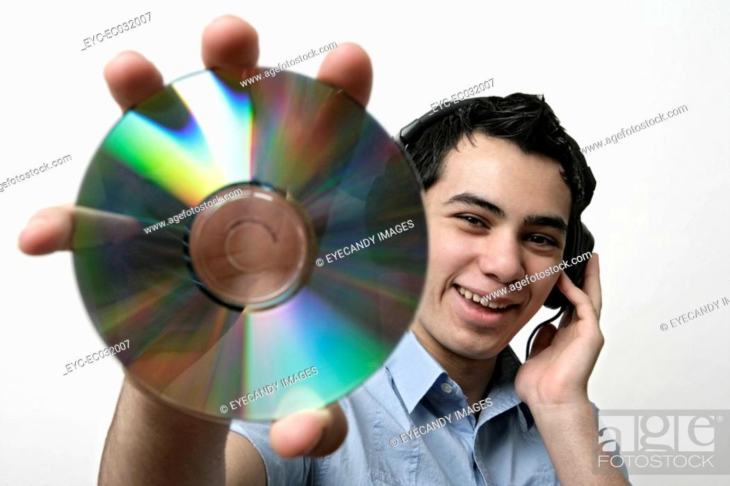 Stock Photo: View of a teenage boy holding a CD.