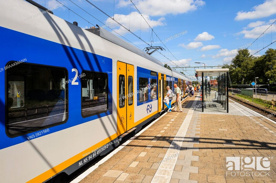 """Stock Photo: OUDENBOSCH, THE NETHERLANDS â. """" September 1: Passenger train rides inside station to let passengers in and out on Setember 1, 2016."""