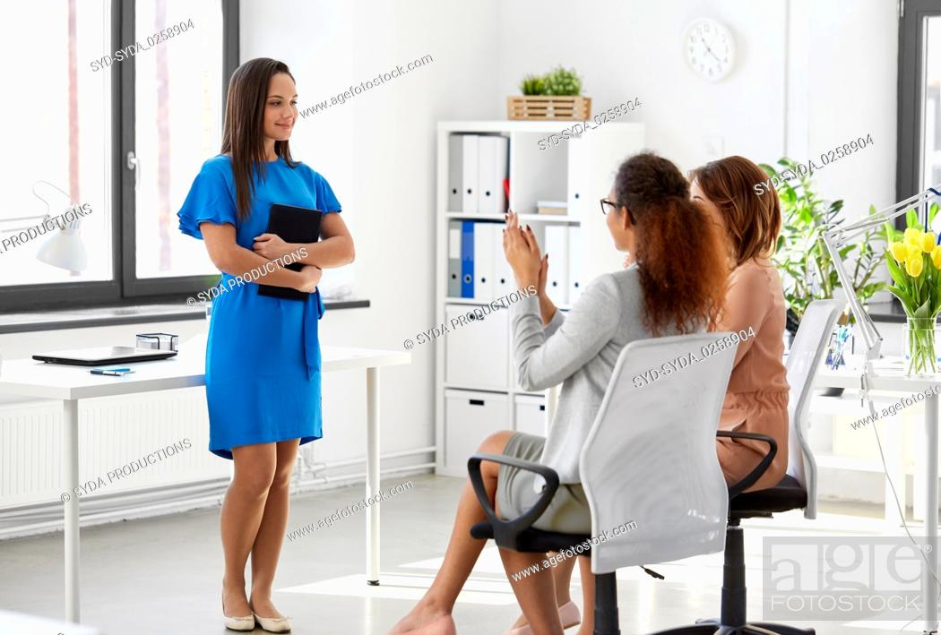 Stock Photo: business team applauding to woman at office.