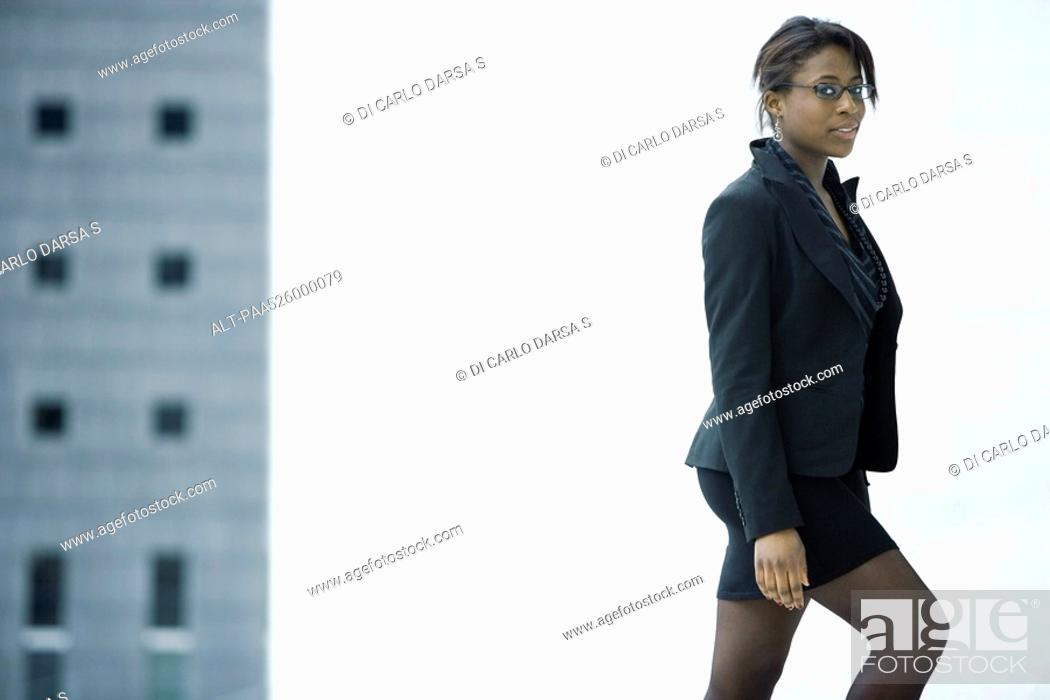 Stock Photo: Businesswoman reaching top of stairs.