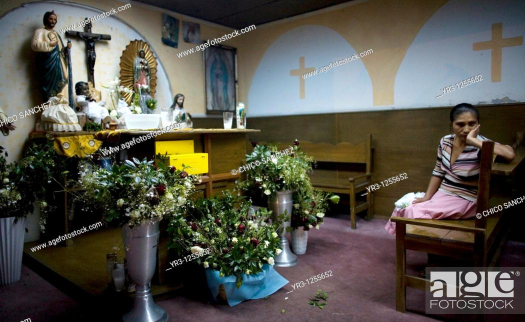Stock Photo: A woman stands in the chapel of a shelter for chronically ill children run by the San Judas Tadeo Foundation in Mexico City.