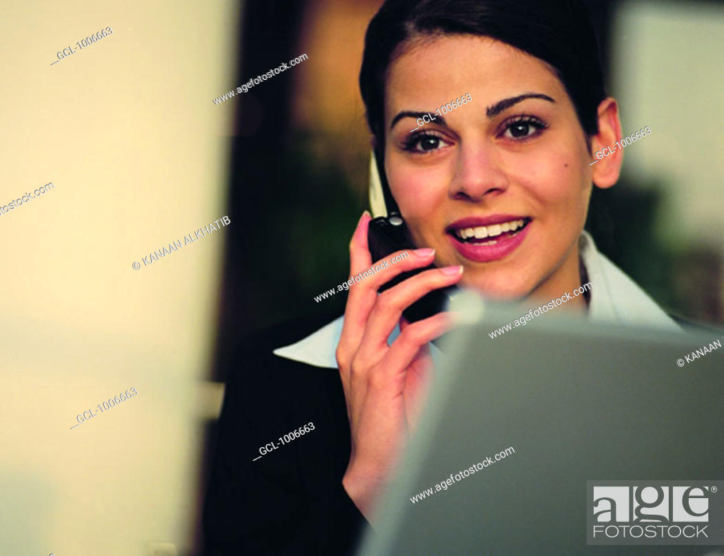Stock Photo: Arab businesswoman using mobile phone.