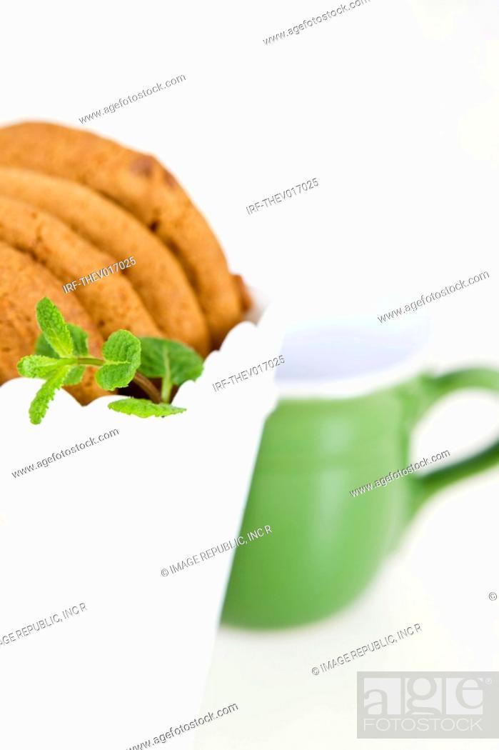 Stock Photo: cookies in paper bag and mug.