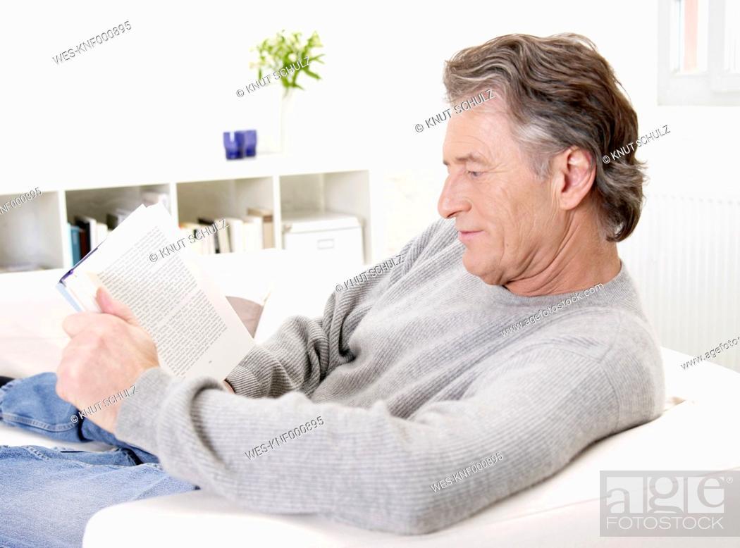 Stock Photo: Germany, Hamburg, Senior man reading book.