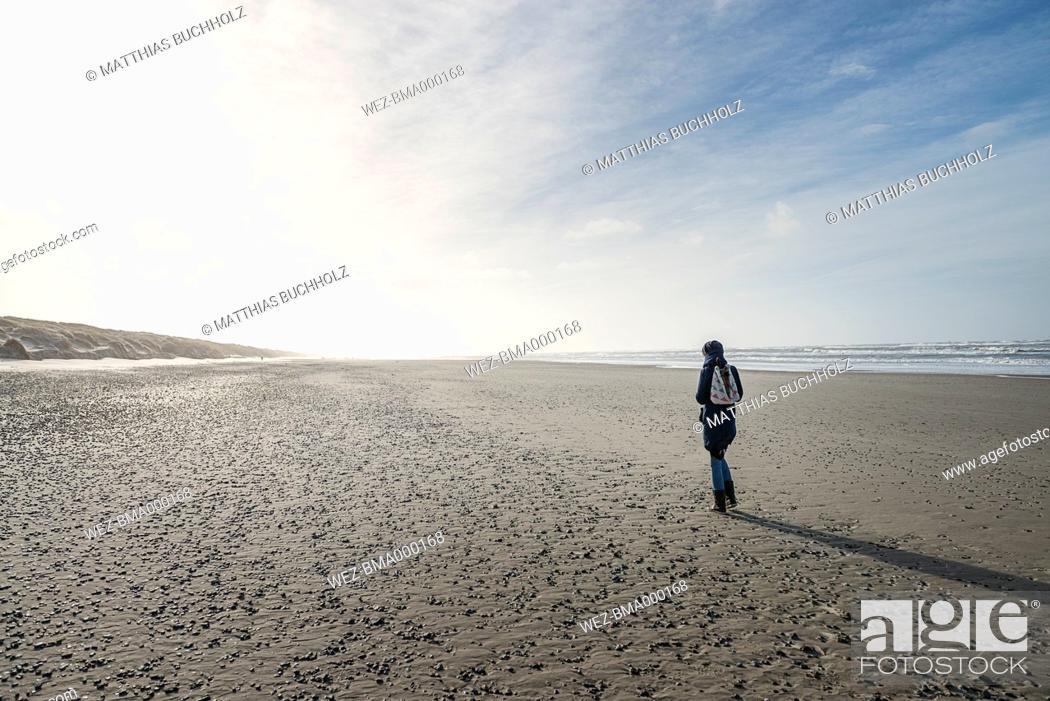 Imagen: Denmark, Henne Strand, Person walking alone on the beach.