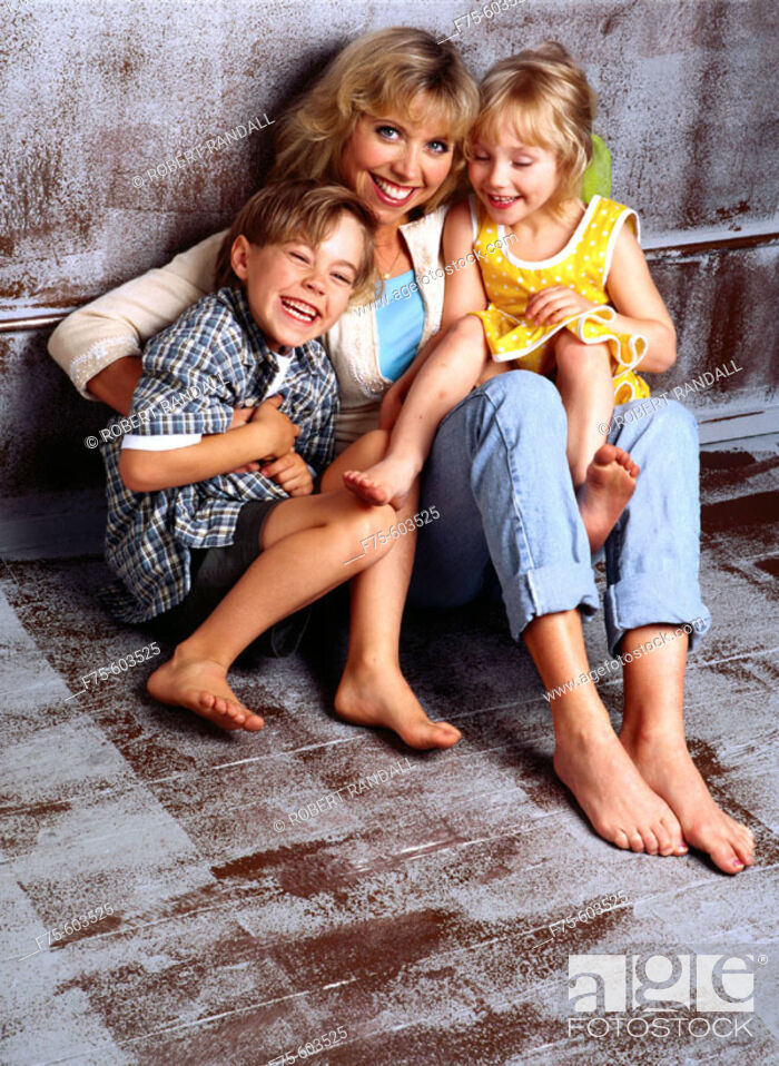 Stock Photo: Mother and children.