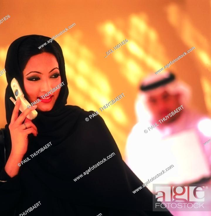 Stock Photo: Arab woman using cell phone.