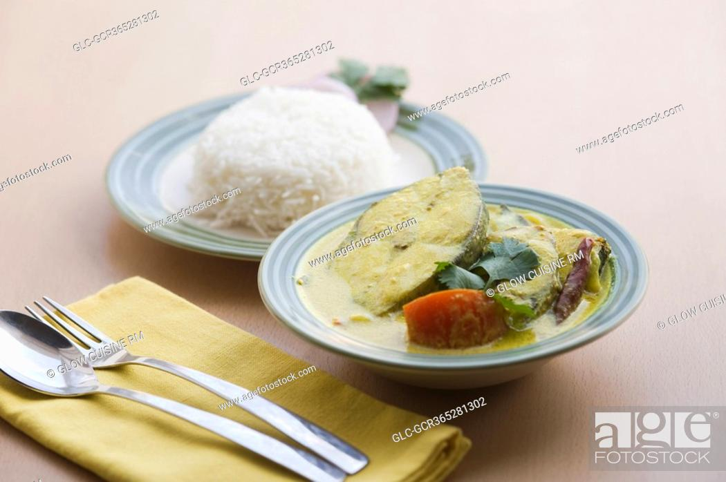 Stock Photo: Close-up of fish curry served with rice.