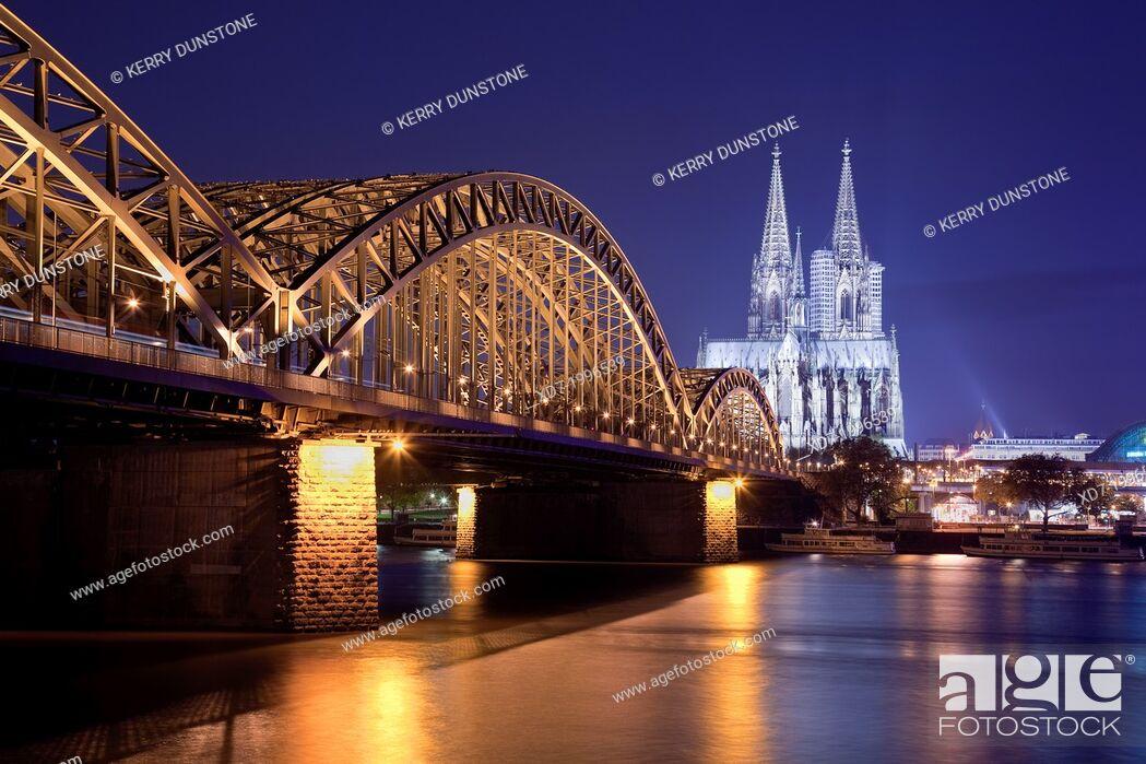 Stock Photo: Cologne Cathedral with River Rhine and Hohenzollern Brucke (Bridge), Cologne, Rhine-Westphalia, Germany.